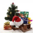 Sledge and gifts under the Christmas tree — Stock Photo #7629877
