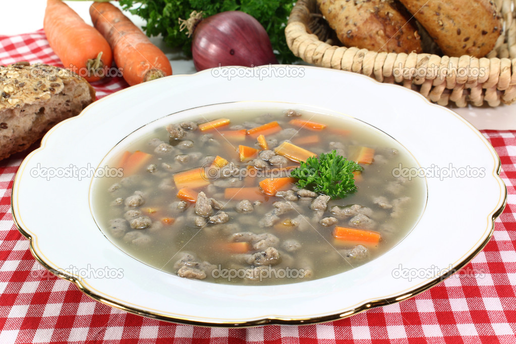 A plate of soup with liver dumplings carrots and parsley  Stock Photo #6835903