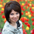 Pretty girl with tulips — Stok fotoğraf