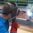 Welder working with metal construction — Stock Photo #7527791