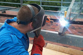 Welder working with metal construction — Stock Photo