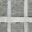 A wall of textured gray construction bricks. — Stock Photo