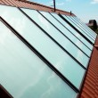 Solar panels (geliosystem) on the house roof. - Stock Photo