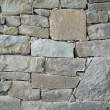 A wall of textured natural stones. — Stock Photo