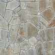 A wall of textured natural stones. — Stock Photo #7717043