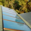 Stock Photo: Solar panels (geliosystem) on the house roof.