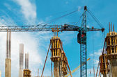 Building crane and the columns. — Stockfoto
