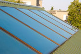 Solar panels (geliosystem) on the house roof. — Stock Photo