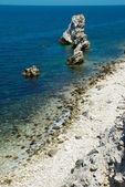 A coastline with many big rocks. — Stock Photo