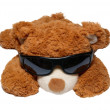 Brown toy bear in sunglasses isolated on white. — Stock Photo