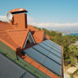 Alternative energy- solar system on the house roof. - Stock Photo