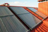 Alternative energy- solar system on the house roof. — Stock Photo