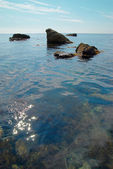 Sea landscape with rocks and water surface. — Stock Photo