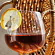 Glass of cognac with lemon - Foto Stock