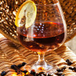 Glass of cognac with lemon — Stock Photo