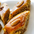 Eastern sweets: baklava with the nuts, closeup of eastern sweet dessert — Stock Photo #7644508