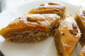 Eastern sweets: baklava with the nuts, closeup of eastern sweet dessert — Stock Photo