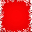 Christmas red background with snowflakes pattern — Stockvektor