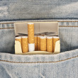 Closeup to jeans pocket with cigarettes — Stock Photo #7397694