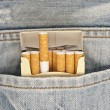 Royalty-Free Stock Photo: Closeup to jeans pocket with cigarettes