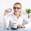 Smiling businesswoman holding a pill. — Stock Photo
