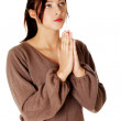 Young girl standing and praying. — Stock Photo #7646973