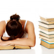 Young girl sleeping on the book. — Stock Photo