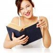 Smiling girl holding an open book. — Stock Photo #7648117