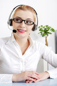 Smiling blonde woman with headset. — Stock Photo