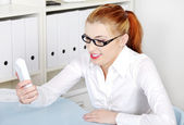 Woman screaming on telephone receiver. — Stock Photo