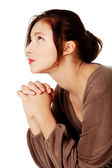 Young girl praying and looking up. — Stock Photo