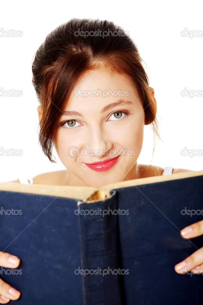 Closeup portrait of young pretty caucasian girl  holding open book over white background. — Stock Photo #7648223