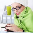 Stock Photo: Businesswomwrapped on blanket feeling cold.
