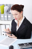 Businesswoman using a tablet. — Stock Photo