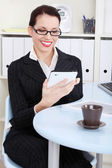 Businesswoman looking at tablet. — Stock Photo