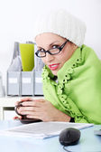 Businesswoman wrapped on blanket feeling cold. — Stockfoto