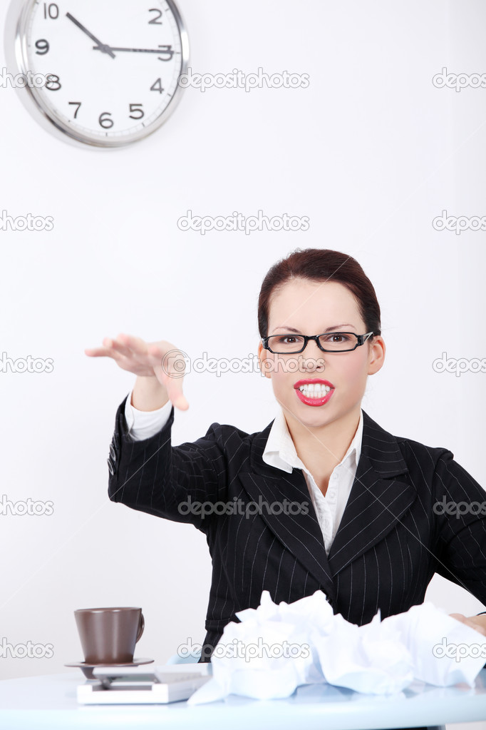 Pretty caucasian mad businesswoman throwing paperball in the office. — Stock Photo #7651331