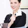 Pretty businesswoman showing white card. — Stock Photo