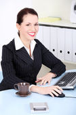 Beautiful business woman in office. — Stock Photo