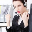 Beautiful business woman shouting through the headphones.. — Stock Photo