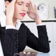 Businesswoman having headache. — Stock Photo #7842898