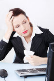 Beautiful business having a headache in office. — Stock Photo