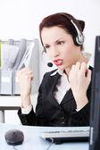 Beautiful business woman shouting through the headphones.. — Stock Photo
