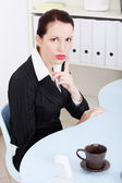 Beautiful business woman showing to be silent. — Stock Photo