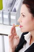 Closeup on smoking businesswoman — Stock Photo