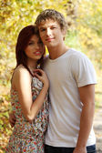 Portrait of young couple on stroll. — Stock Photo