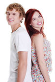 Smiling couple standing back to back. — Stock Photo