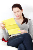 Beautiful woman having a look at the documents. — Stock Photo