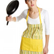 Upset female teen with a frying pan. — Stock Photo