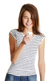 Happy caucasian teen with a mobile. — Stock Photo